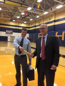 Me handing a relay baton to Steve Wilcox